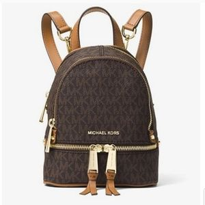 536dc65ddc2437 Women Michael Kors Rhea Backpack on Poshmark